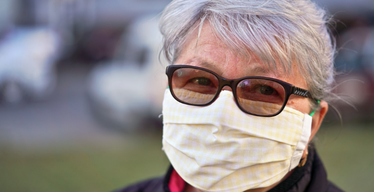 older lady with glasses wearing a mask