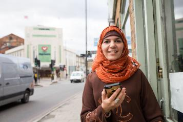 Smiling woman holding her phone