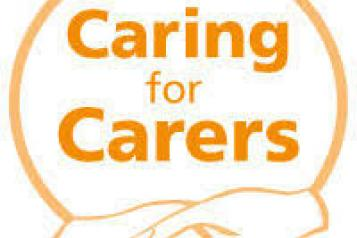 sign that reads 'caring for carers'