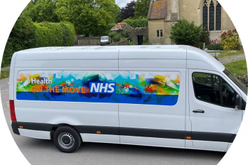 white van with logo on the side saying health on the move