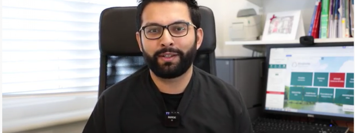 doctor talking to camera while sitting at desk