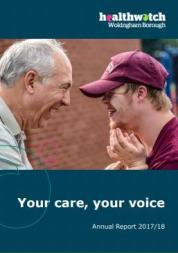 man talking with learning disabled young man